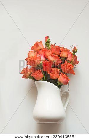 Gentle Orange Roses In Vase On White Background. Spring Concept. Top View. Floral Pattern. Matte.