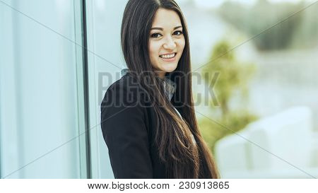 Young Prospective Female Employee On The Background Of A Large Window In The Office
