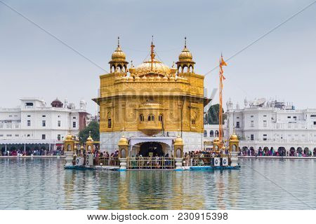 AMRITSAR, INDIA -  MARCH 1, 2015: Pilgrims at the Golden Temple, the holiest Sikh gurdwara in the world.