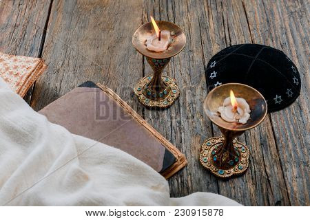 Sabbath Image. Matzah, Bread And Candelas On Wooden Table