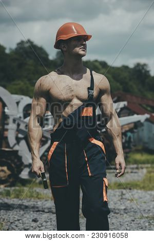 Man, Builder Or Bodybuilder With Strict Face In Hard Hat. Sexy Handyman Concept. Muscular Builder In
