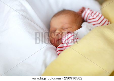 Cute Adorable Peaceful Newborn Baby Sleeping In White Bed. New Born Child, Little Girl Six Days Old