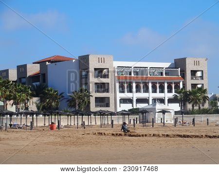 Agadir, Morocco Africa On February 2017: Modern Hotel Building And Umbrellas On Beach At Seaside In