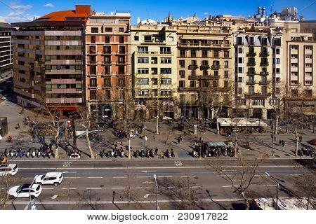 BARCELONA, SPAIN - MARCH 3, 2018: Aerial view of Passeig de Gracia street, one of the most famous streets in Barcelona. It is an important shopping area and contains important buildings of the city