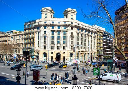 BARCELONA, SPAIN - MARCH 3, 2018: A view of Passeig de Gracia street, one of the most famous streets in Barcelona. It is an important shopping area and contains important buildings of the city
