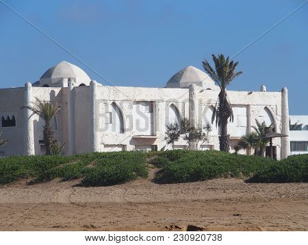 Beach At Seaside In Travel Agadir City In Morocco With White Modern Hotel Building And Palms In Beau
