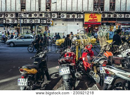 Tehran, Iran - October 15, 2016: A Row Of Parked Motorbikes Next To Busy Street In Tehran