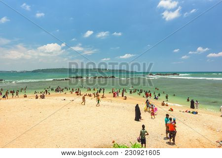 Galle, Sri Lanka - March 22, 2016 : People Of Sri Lanka Are Swimming In The Beach At Galle City On M