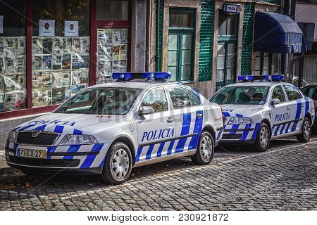 Porto, Portugal - December 8, 2016: Two Police Cars Parked On A Street In Cedofeita District Of Port