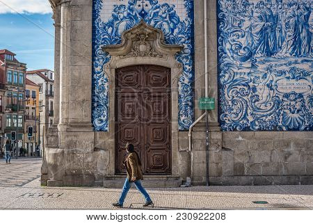 Porto, Portugal - December 8, 2016: Side View Of Carmo Church Covered With Azulejo Tiles In Porto