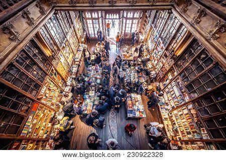 Porto, Portugal - November 13, 2017: Customers And Tourists In Famous Lello Bookstore In Porto, Cons