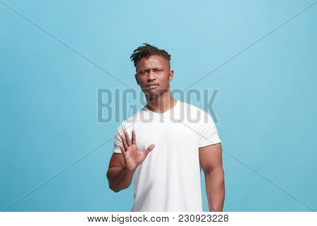 Young Man With Disgusted Expression Repulsing Something, Isolated On The Blue