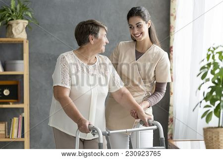 Friendly Caregiver Supporting Senior Patient