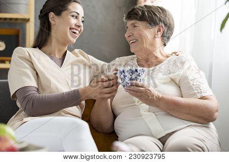 Granddaughter And Smiling Senior Woman