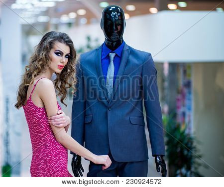 Girl In Red Dress, Makeup, Long Hair With Fashion Dummy. Sensual Woman With Male Mannequin In Clothi