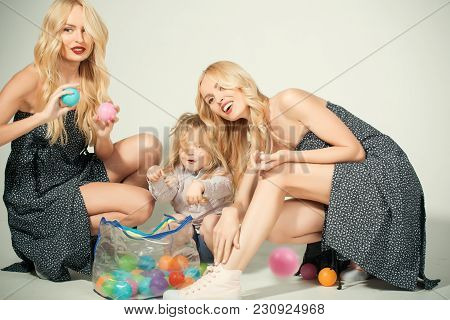 Mothers Day, Family Values, Trust, Childhood. Happy Family Play With Toy Balls. Mother And Son, Happ