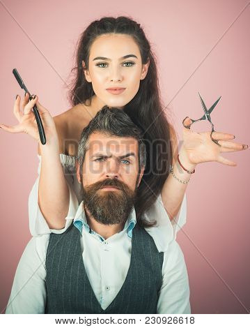 Happy Positive Woman And Bearded Man, Hairdresser In The Salon. Serious Brutal Man Hairdresser Makin