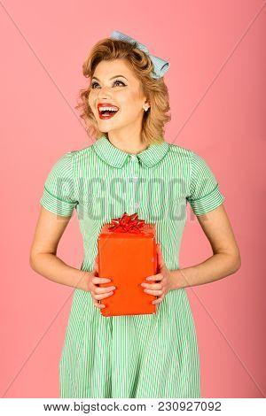 Boxing Day, Black Friday, Birthday. Sexy Blond Girl With Retro Makeup Hold Present Box. Retro Woman