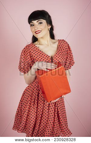 Gifts And Holidays Concept. Attractive Woman With Makeup