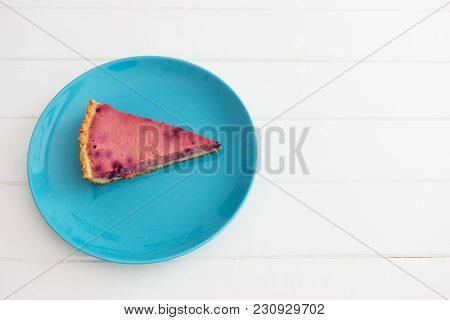 Wedge Currant Tart Blue Plate White Wooden Background.