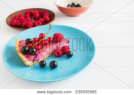 Wedge Currant Tart Decorated Blue Brown Plate Bowl White Wooden Background.