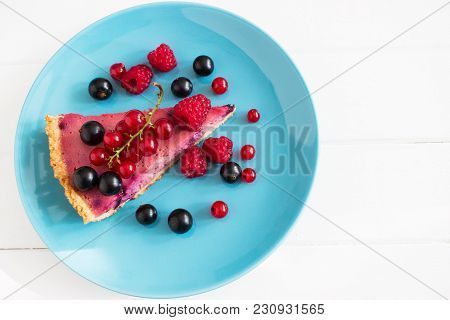 Wedge Beautiful Ripe Currant Tart Top View Blue Plate.