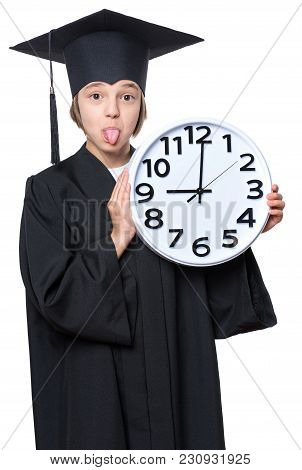 Portrait Of Graduate Girl Student In Black Graduation Gown With Hat, Holding Big Clock - Isolated On