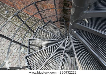 The Downward Spiral, Spiral Staircase In Old Town In Warsaw, Poland