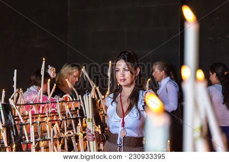 El Rocio, Spain-may 22, 2015 Women Light Candles At Festival Of Romeria. El Rocio Spain