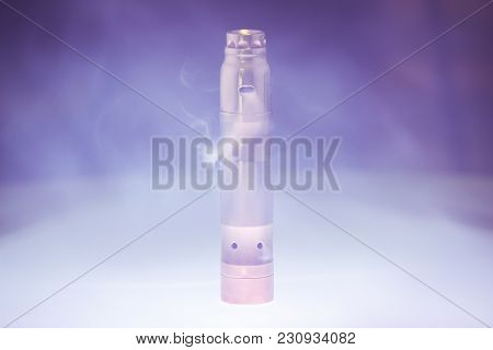 Electronic Cigarette With Steam In Smoke On A Dark Background.