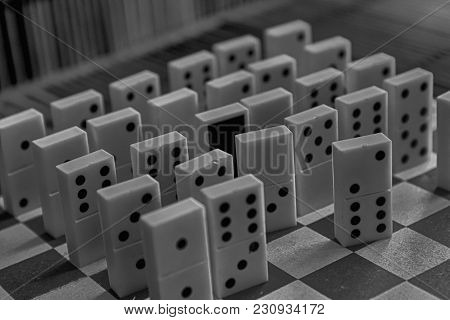 Monochrome Domino Pieces In A Row, Back Side On The Bamboo Brown Wooden Table Background