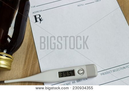 Digital Thermometer With High Temperature On Blank Prescription And Bottle Of Syrup