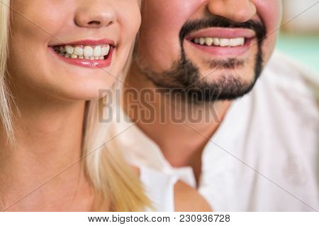 Beautiful Woman And Man Smile. Teeth After Whitening. Dental Health Background