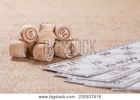 Board Game Lotto On Sackcloth. Wooden Lotto Barrels And Game Card For A Game In Lotto