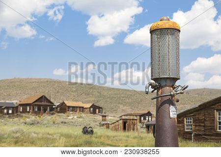 Bodie, California, Usa - August 31, 2017 : Old Gas Pump And Buildings In Bodie Ghost Town, Californi