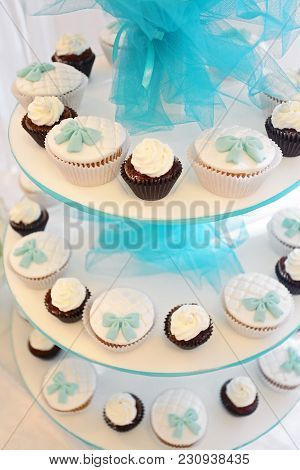 Candy Bar. Cupcakes, Decorated With A Delicious Sweet Buffet, The Concept Of A Festive Table, A Buff