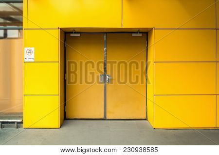 Emergency Fire Exit Door And Aluminum Composite Wall Of Warehouse.