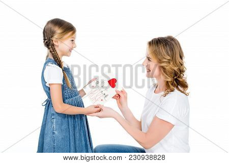 Smiling Daughter Giving Greeting Card To Mom, Isolated On White, Mothers Day Concept