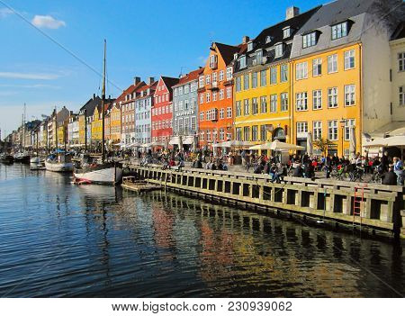 Copenhagen, Denmark - April 15, 2010: Nyhavn, Famous And Popular Tourist Destination Pier With Color