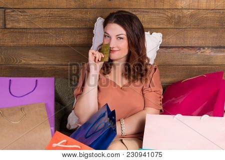 Woman After Shopping On Bed With Paper Bags, Credit Card
