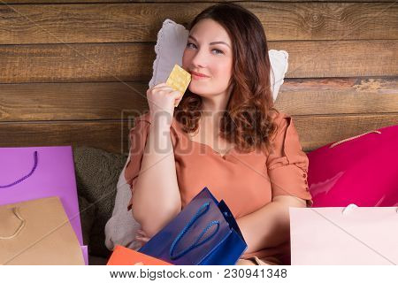 Woman After Shopping On Bed With Paper Bags, Banking Card