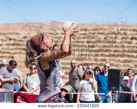 Caesarea, Israel, March 03, 2018 : A Participant Of The Purim Festival Shows A Show With Soap Bubble