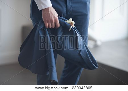 Groom In Blue Suit With A White Rose Boutonniere. Close Up