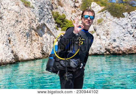 Scuba Diver Is Showing The Ok Sign Before A Dive