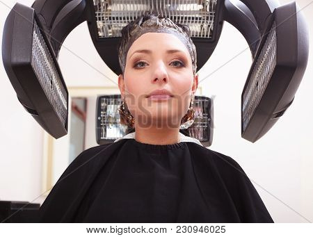 Brunette Young Woman In Hairdressing Beauty Salon. Girl Dying Colouring Hair By Hairstylist Hairdres