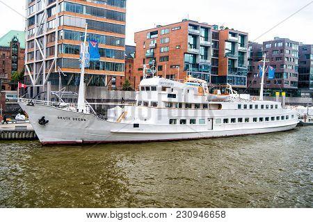 Hamburg, Germany - September 07, 2017: Ship At Ferry Pier On Cityscape Background. River Transport,