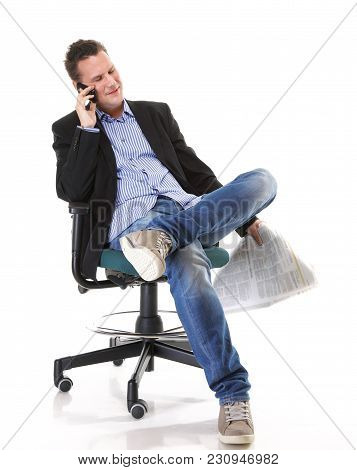 Full Length Businessman Reads Newspaper Phoning Talking On Mobile Phone Commenting Economy News Isol