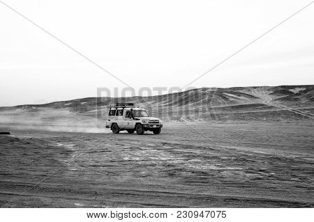 Hurghada, Egypt - February 26, 2017: Offroad Vehicle Driving Through Sand Dunes In Desert On White S