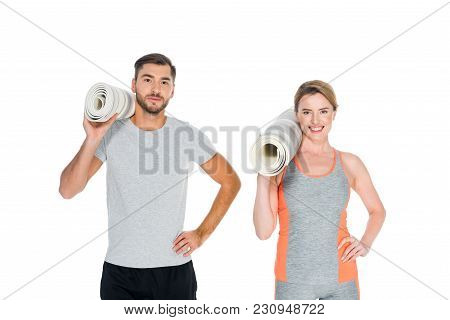 Portrait Of Athletic Couple With Yoga Mats Isolated On White