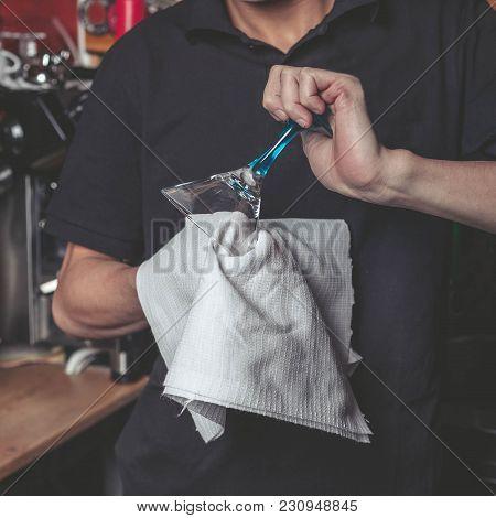Barmen Polishing A Towel A Martini Glass. Work Concept